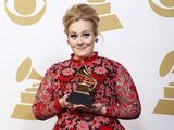 Adele-poses-with-her-grammy-award-for-best-pop-solo-performance-for-her-song-set-fire-to-the-rain-live-backstage-at-the-55th-annual-grammy-awards-in-los-angeles-california-february-