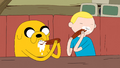 S5e10 Finn and Jake eating sassages.png