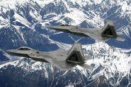 800px-F-22 Raptor pair over Alaska - 081010-F-1234X-924