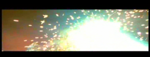 Godzilla blasts off Keizer Ghidorah's middle head.