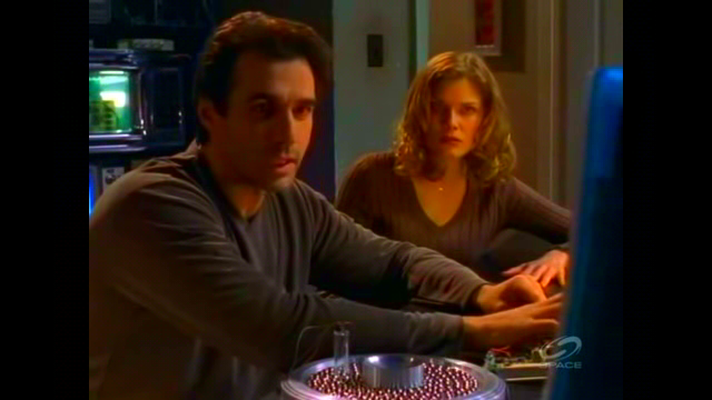 File:Cole and Mel search for the 'contaminated' life force..png