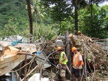 800px-Crews Damage from Tsunami American Samoa