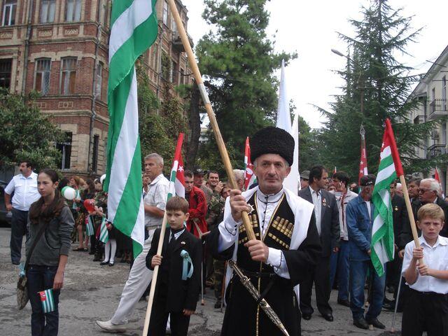 File:Apsua Holding Apsny Flag.jpeg