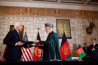 John McCain Hamid Karzai signing strategic partnership agreement