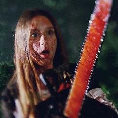 Zoe killing a zombie