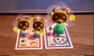 Tommy and Tom Nook Joy Take Photos With Animal Crossing