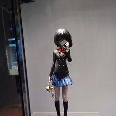 A figurine based on Mei in her school uniform. This is from the scene she first met Kouichi in, hence the doll.