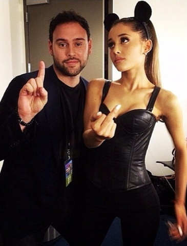 File:Ariana with scooter flipping off the camera.png