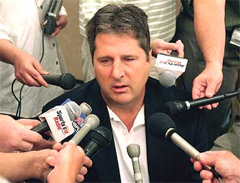 File:Mike Leach surrounded by microphones.jpg