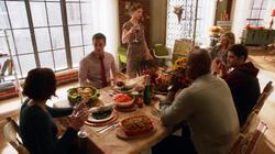 Kara prepares to toast at Thanksgiving