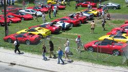 800px-Ferrari parking lot at USGP 2005