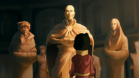 Jinora looking at Aang's statue