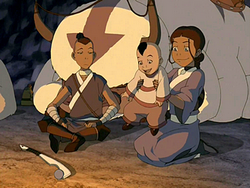 Katara holds Tom-Tom