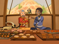 Aang and Katara eat