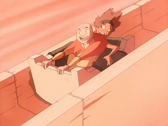 File:Young Bumi and Aang sliding.png