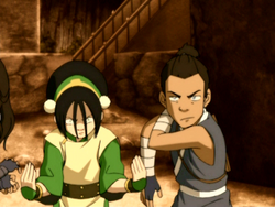 Toph and Sokka prepare to fight