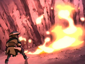 Soldier evading a fire blast