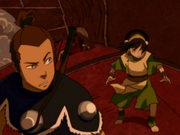 Toph and Sokka atop airship