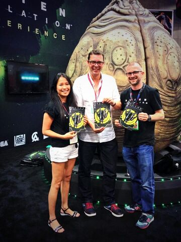 File:Isolation cast holding comics at SDCC.jpg