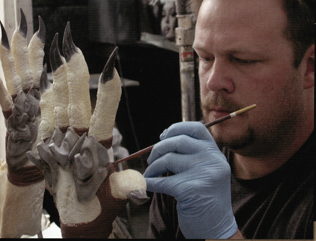File:Brian Clawson paints gloved Predator.png