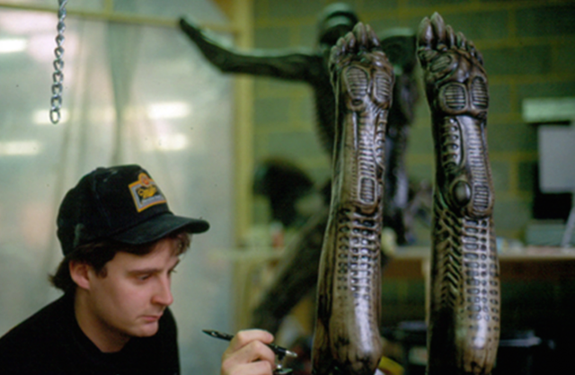 File:Alien 3 feet extensions for the alien costume being airbrushed by Yuri Everson,.png