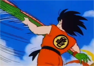 Goku Swinging Piccolo by his Arm