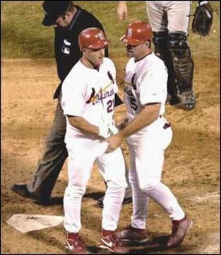 File:Borderline Hall of Fame Candidate Jim Edmonds shows the rookie he's proud of the way he's been catching on..jpg