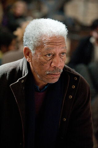 File:TDKR Lucius Fox.jpg