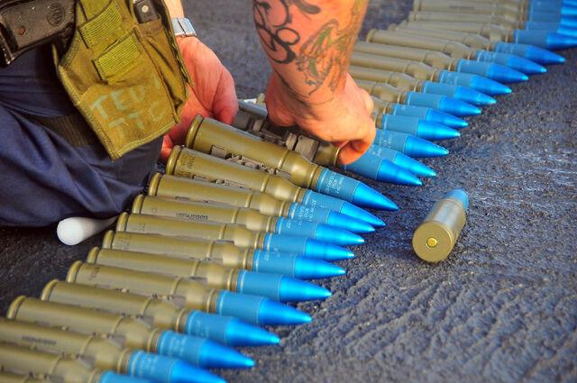 File:US Navy 090129-N-4774B-008 Gunner's Mate 2nd Class Nicholas Brassard inspects rounds for the MK-38 25mm machine gun system.jpg