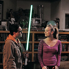 Leonard shows off his light saber to Penny.