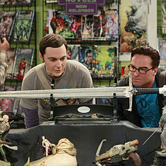 Sheldon and Leonard looking at a sword.