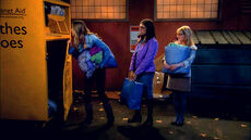 Amy and the girls donating Penny's clothes