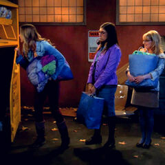 Amy and Bernadette help Penny carry the clothes that she wants to donate, as part of her mission to show altruism