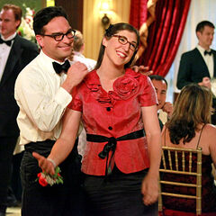 Amy and Leonard having fun at a wedding.