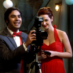 Raj and Emily taking pictures.