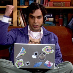 Raj playing on his laptop.