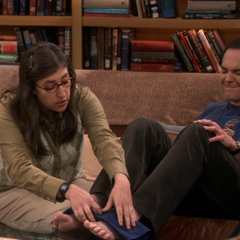Amy making Sheldon feel better.