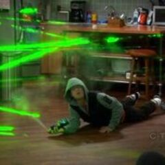 Leonard playing the laser game.