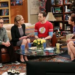 Both mothers are discussing Sheldon's brilliance and Leonard is jealous.