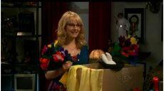 Bernadette holding magic equipment