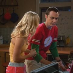 Sheldon helping Penny at a low level.