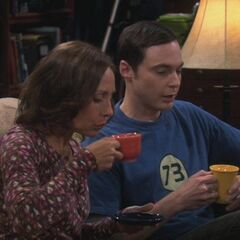 Mary and Sheldon drinking tea.