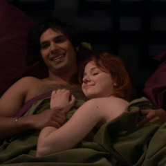 Raj and Emily in bed after a good talk.