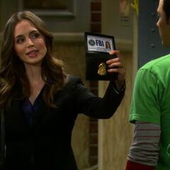 Showing Sheldon her badge.