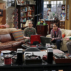 The guys discussing at Leonard and Sheldon's apartment.