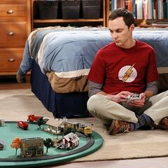 Sheldon playing with his train.