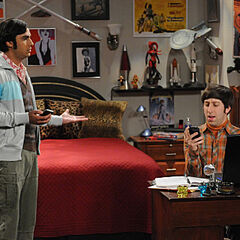 Raj and Howard in his room, using their phones.