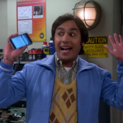 Raj miming an emoticon.
