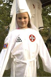 Kkk-child-in-robe1
