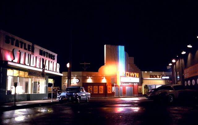 File:Statler Studebaker, Louis Watch Maker, Town Theater and Holt's Diner by night.jpg